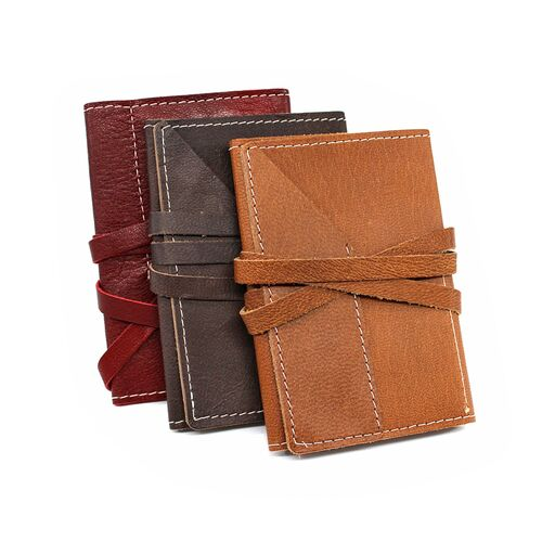 Leather Wrap Accessory Case in red, brown, and tan color options